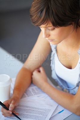 Buy stock photo Young business woman reading the document