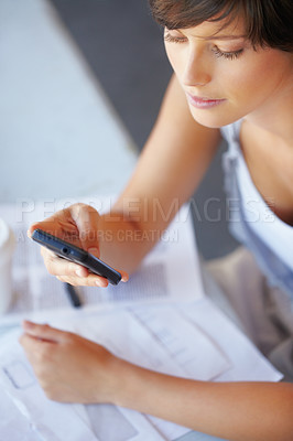 Buy stock photo Young business woman reading text message on her mobile