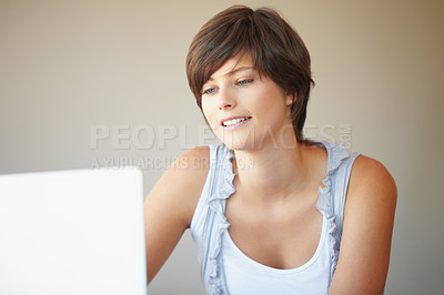 Buy stock photo Smiling business woman busy on laptop