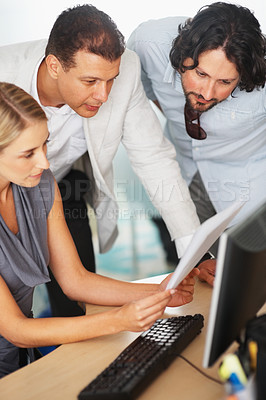 Buy stock photo Young woman showing project to her colleagues at office