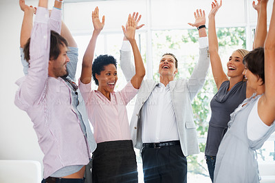 Buy stock photo Group of business people raising hands in joy