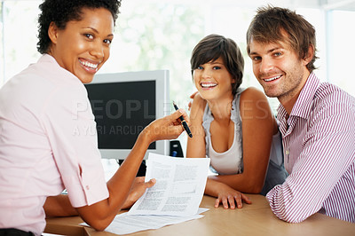 Buy stock photo Happy confident advisor with couple in the offices