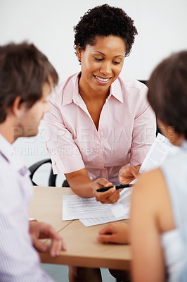 Buy stock photo Female consultant advising couple with financial papers