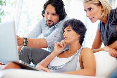 Buy stock photo Leader showing female executives something on laptop at office