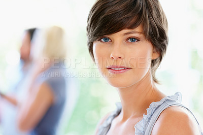 Buy stock photo View of attractive woman with group of people in background