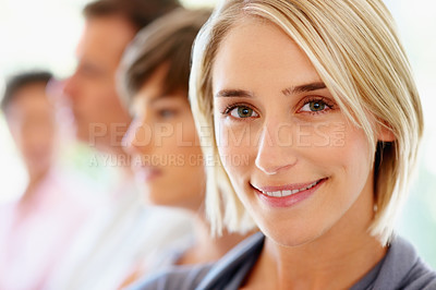 Buy stock photo Pretty blonde woman with colleagues in background