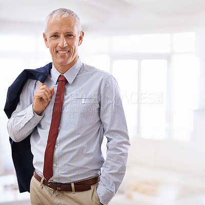 Buy stock photo Cropped shot of a mature businessman looking relaxed