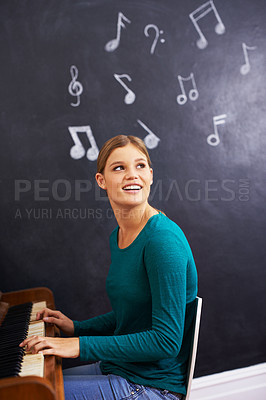 Buy stock photo Shot of a woman playing the piano against a background of musical notes