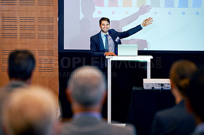 Buy stock photo An excited businessman gesturing while giving a presentation at a press conference