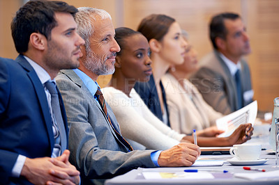Buy stock photo Shot of a group of people sitting in a conference