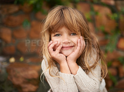 Buy stock photo Cropped shot of a cute little girl sitting outside on an autumn day