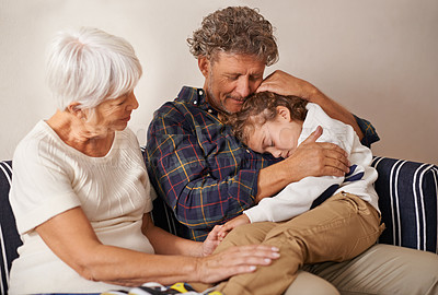 Buy stock photo A little boy asleep in his grandfather's arms with his grandmother sitting by