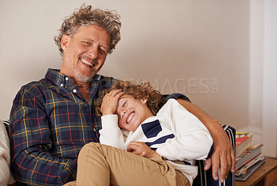 Buy stock photo Portrait of a grandfather spending quality time with his grandson indoors