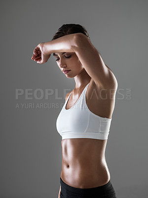 Buy stock photo Shot of an attractive woman looking tired after her daily workout