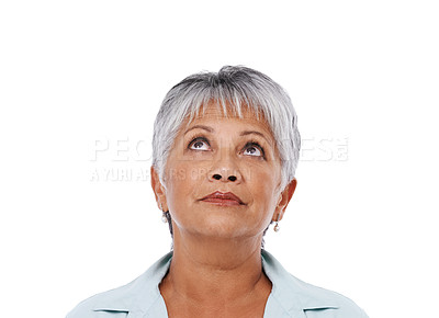 Buy stock photo Studio shot of a mature woman looking up isolated on white