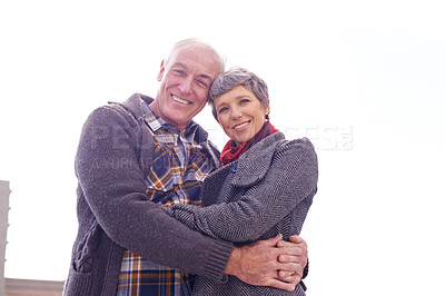 Buy stock photo Portrait of a happy senior couple enjoying an affection filled moment outdoors