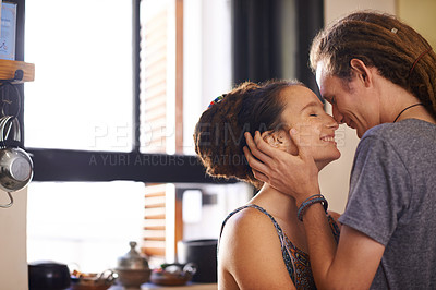 Buy stock photo Shot of an affectionate young rastafarian couple at home