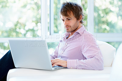 Buy stock photo View of man indoors, working at laptop