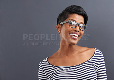 Buy stock photo Portrait of a happy young woman standing on a gray background