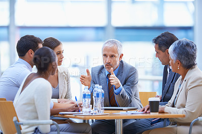Buy stock photo A cropped shot of a diverse group of businesspeople having a meeting