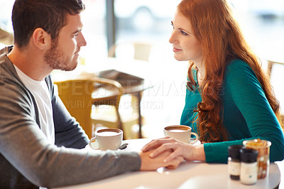 Buy stock photo Cropped shot of a young affectionate couple on a coffee date