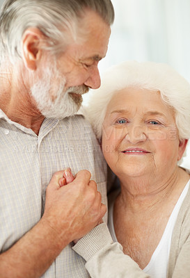 Buy stock photo Portrait of a happily married and caring senior couple