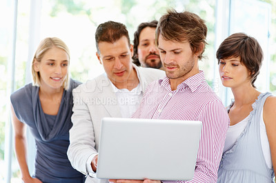Buy stock photo Group of people looking at laptop