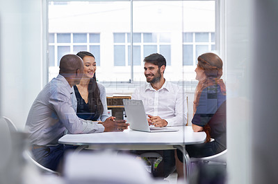Buy stock photo A group of businesspeople having a meeting in a boardroom at work