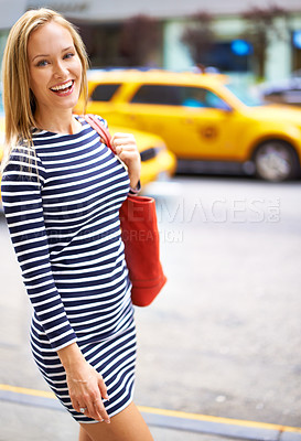 Buy stock photo Shot of a gorgeous woman walking in the city