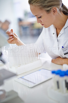 Buy stock photo Logging her findings online
