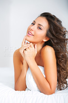 Buy stock photo Shot of a gorgeous young woman lying on a bed