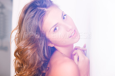 Buy stock photo Shot of a beautiful young naked woman leaning against a wall