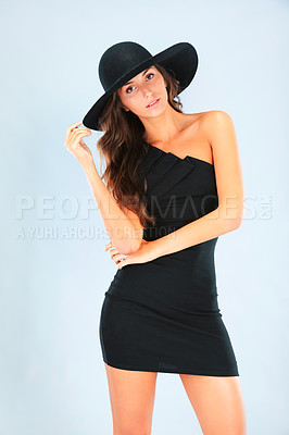 Buy stock photo Cropped shot of a gorgeous brunette in a sexy black dress