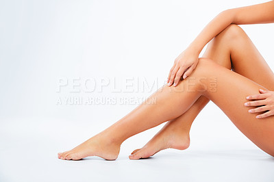 Buy stock photo Closeup of a young woman's legs against a white background