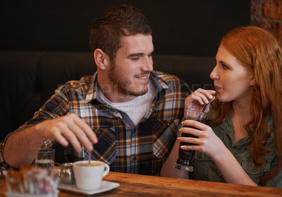 Buy stock photo Cropped shot of a loving young couple on a coffee date
