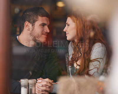 Buy stock photo Shot of a loving young couple on a date