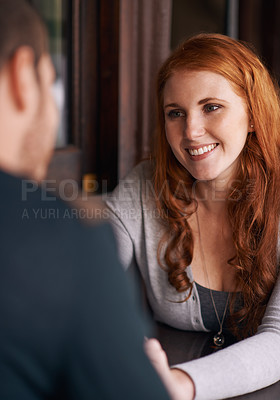 Buy stock photo Shot of an attractive young woman on a date with her boyfriend