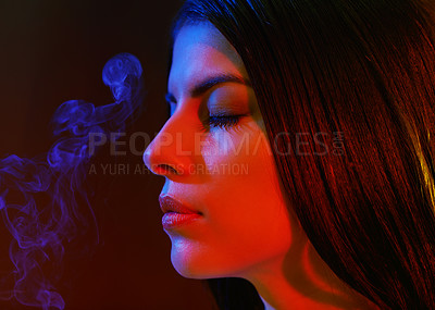 Buy stock photo Studio shot of a beautiful young woman with artistic lighting