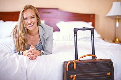 Buy stock photo Portrait of a beautiful businesswoman relaxing in a hotel room