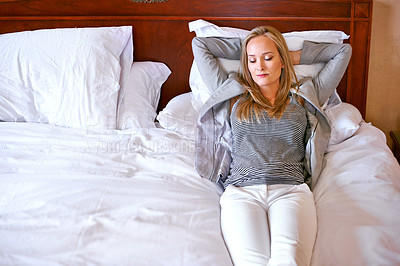 Buy stock photo Cropped shot of an attractive young woman relaxing on her bed