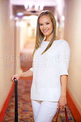 Buy stock photo Shot of an attractive young woman arriving at her hotel suite