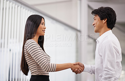 Buy stock photo Side view of two business partners shaking hands