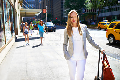 Buy stock photo A beautiful woman walking around a city with her luggage