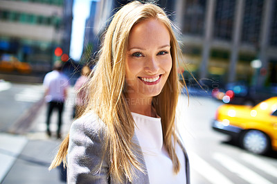 Buy stock photo A cropped shot of a beautiful woman walking around the city in the day time