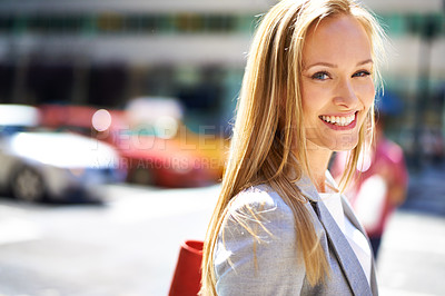 Buy stock photo A portrait of a beautiful young woman in the city