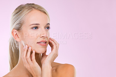 Buy stock photo A fresh-faced blonde woman looking natural against a pink background
