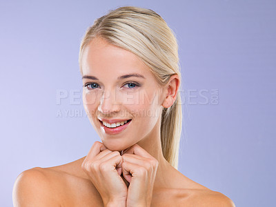 Buy stock photo Portrait of a fresh-faced blonde woman against a purple background