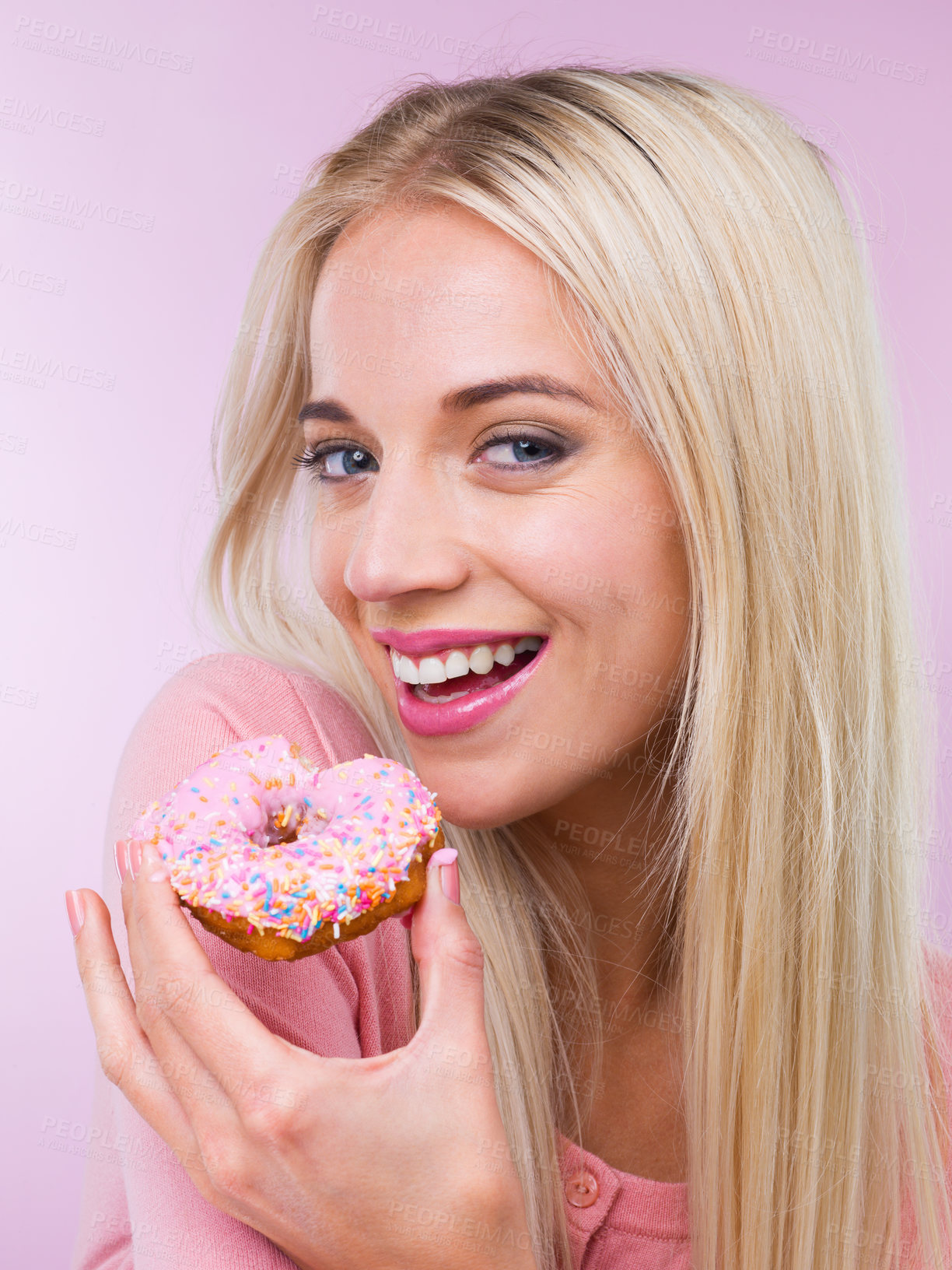 Buy stock photo Cropped shot of a woman eating a donut while isolated on pink