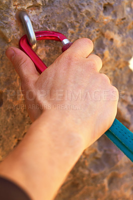 Buy stock photo Closeup of a climber's hands clipping a quickdraw onto a hook bolted into a rock