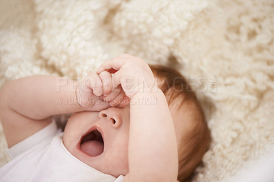 Buy stock photo Shot of an adorable baby yawning